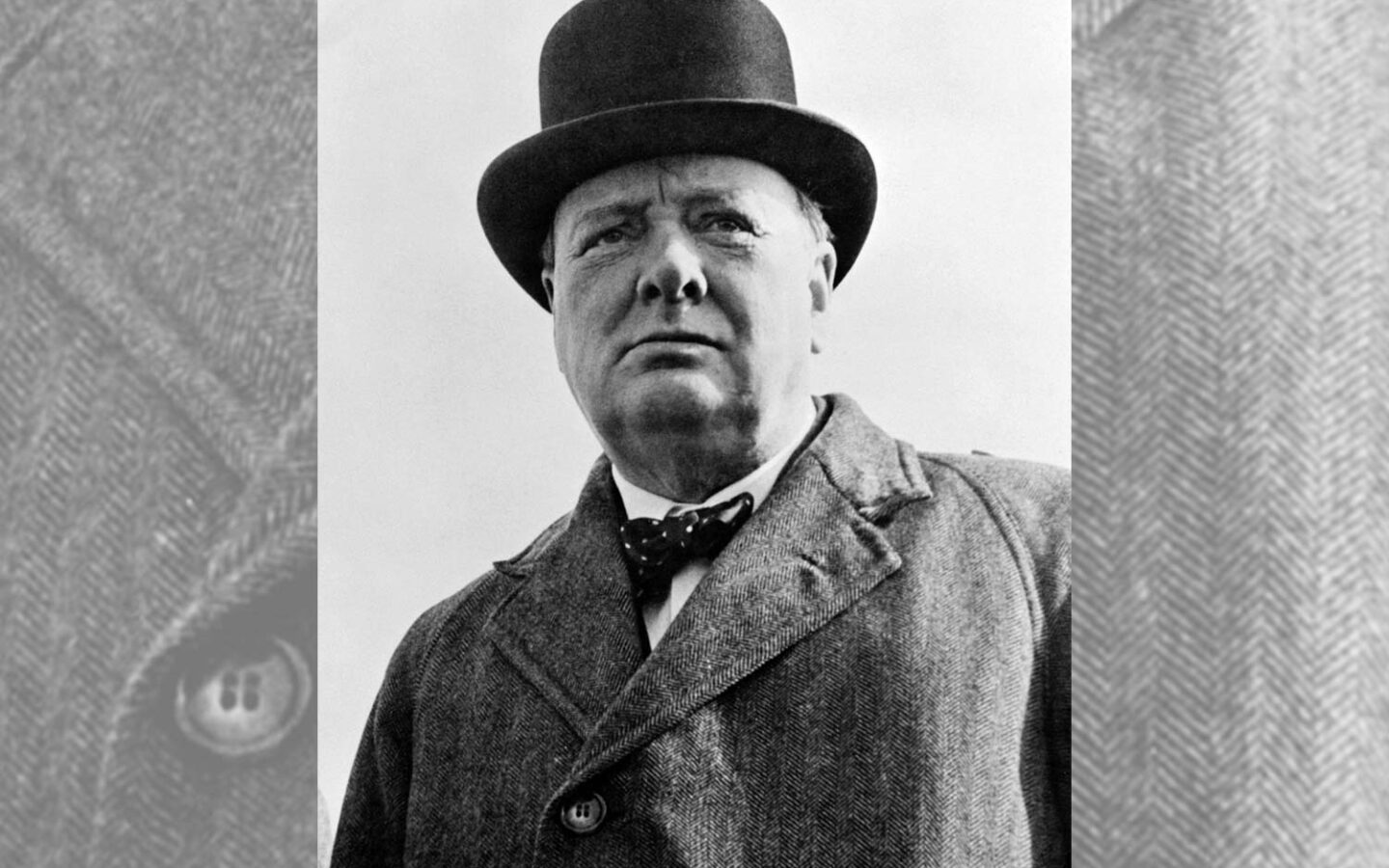 historical black and white photo of a man in a top hat
