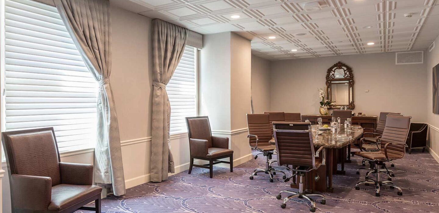 boardroom with large windows and curtains