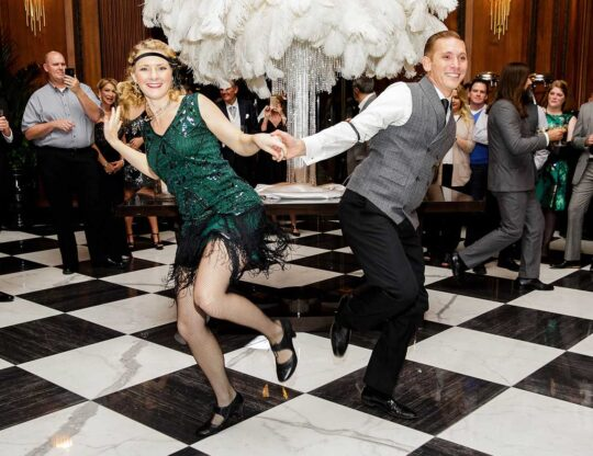 two people dressed up Gatsby style dancing on the dancefloor